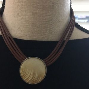 Necklace with leather strands and beige stone